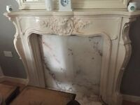 marble fireplace and matching mirror