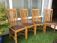 4 Brown leather oak dinning chairs