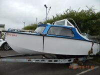 Boat for sale includes outboards and on trailer to go