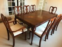 Large mahogany dining table and chairs