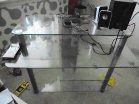 Glass computer desk.