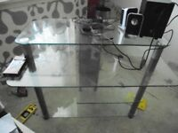 Glass computer desk.