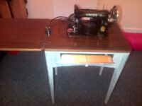 two old singer sewing machine s