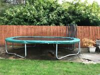 Jumpking Oval Pod Trampoline 15' x10' in very good condition with safety net, ladder and cover