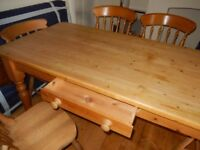 Pine dining room table and six chairs