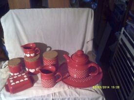 8 PIECES of RED CHINA WITH WHITE HEARTS ON ? TEAPOT TRAY CADDIES JUGS & a BUTTER DISH+
