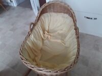 This is a ridged strong Moses Basket from Mothercare with stand ,no mattress good size