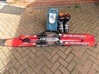 Adult Skies including skis, bindings, poles, boots, ski bag and boot bag.