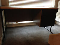 Clean sturdy desk. Brown. 2 drawers on right. Dividers in drawers