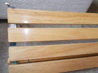 Slatted wooden shelf in clear varnish