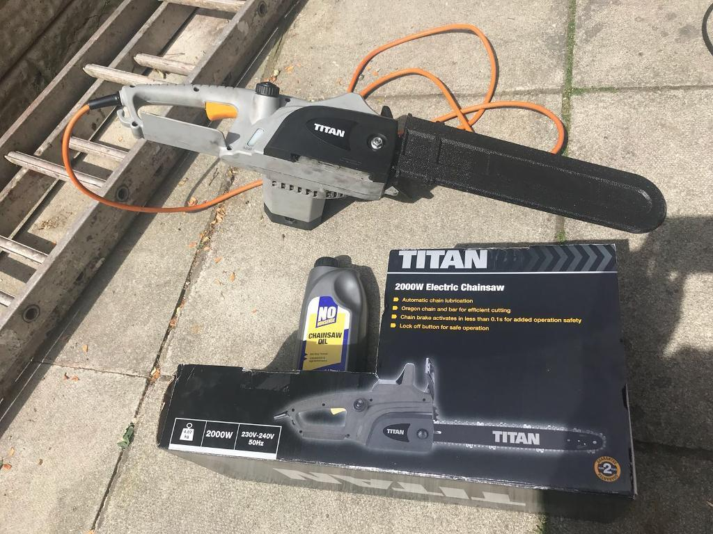 Titan 2000W electric chainsawin Widnes, Cheshire - Only used once. Bought fromScrewfix. Excellent condition. Inc chainsaw oil, instructions and original box