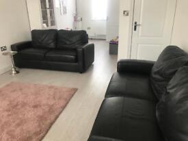 2 x leather settee sofas with storage from Homebase
