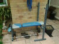 York weight bench + flat bar + curling bar + iron plates