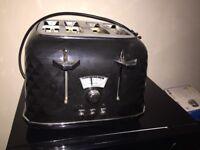 Black modern delongi toaster