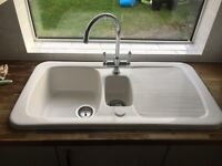 Ceramic white sink with tap