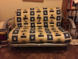 Comfortable 2-3 seater futon style sofa bed with metal frame. Reversible cover, blue or yellow