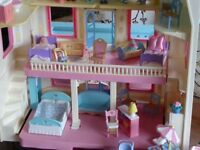 Dolls House and a bundle of furniture is included