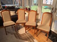 Four teak dining chairs. Good condition