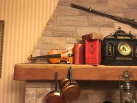 Antique violin for sale.