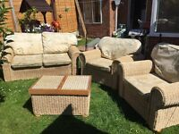 Wicker conservatory suite 2 seater sofa with 2 chairs and a table