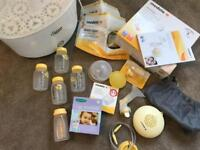 Medela swing breast pump with tommee tippee steriliser and lots of accessories