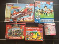 5 boxes of puzzles(paw patrol, vehicles,airplanes,trains,Emily Button Giant Floor Puzzle)