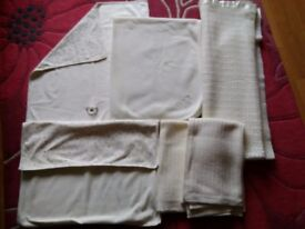 Selection of baby blankets, cream, various sizes.