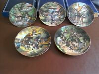 "A collection of 12 Robert Hersey 22ct gold edged plates ""The Victorian Garden"""