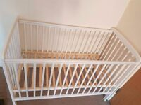 White mothercare cot with plastic teething strips still on top bars