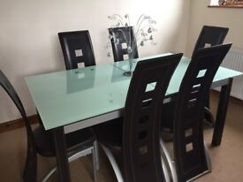 Glass extending dining table & 6 chairs. Some wear as in photos
