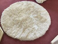 Brand new never used 135 by 135 inches round rug shaggy pile with a shimmer cost £130