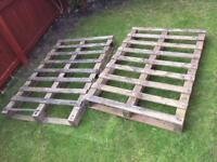 Two large wooden pallets