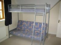 Metal high sleeper 'Sit and Sleep' futon bunk bed incorporating single bed and double sofa bed below