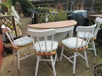 Large round dining table and 4 chairs