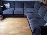 Large grey/black corner sofa and foot pufee