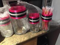 Glass jars with pink and black ribbon $50.00