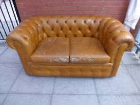 A Tanny/Gold Leather Chesterfield Two Seater
