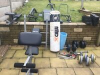 Weights bench 50kg weights spare bars punch bag abs roller mat plus free multigym