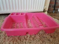 Pink plastic dish drainer