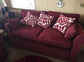 Two seater sofa one armchair wine red in colour