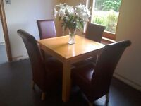 Solid oak dining table and chairs. 90 x 90cm