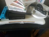 Nintendo wii with accessories and games