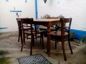 Oak dining table and four chairs