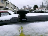 Thule wing bars and 4 x Thule roof mounted bike carriers