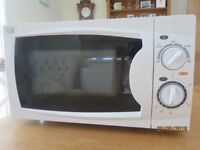 Curry's Essentials 700w Microwave, 17 litre capacity. Used once. As new.