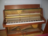 Light brown Kemble upright piano bought new in 1974 good condition tuned regularly