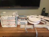 Nintendo Wii console and bundle inc guitar hero, sing and active