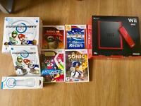 Wii mini + 5 games, Mariokart wheel + Motionplus