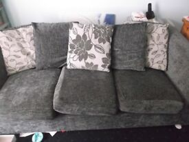 GREY SOFA WITH SCATTER CUSHION BACK