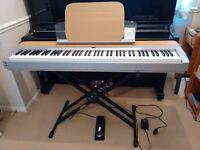 Yamaha P140 digital piano in excellent condition, including hard case, stand, pedal and stool.